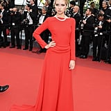 Lottie Moss took a page from her sister's book in a stunning red gown from Dior.