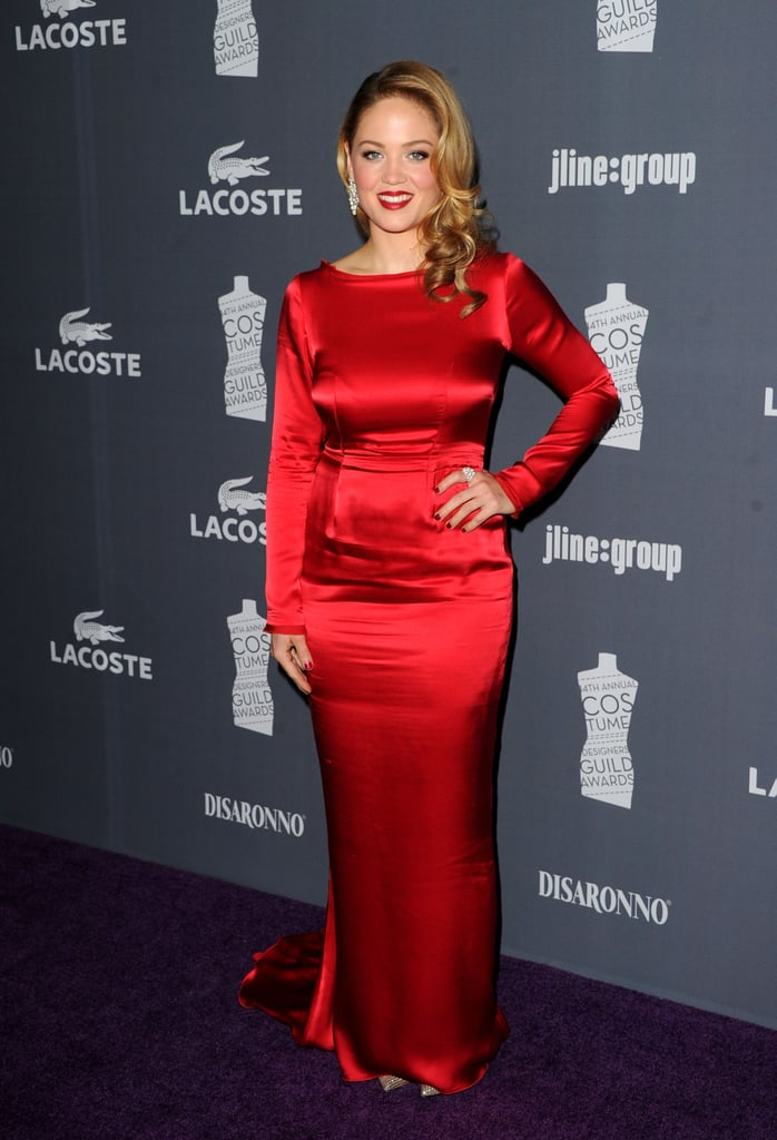 Erika Christensen made a dramatic arrival in a long-sleeve scarlet-red gown.