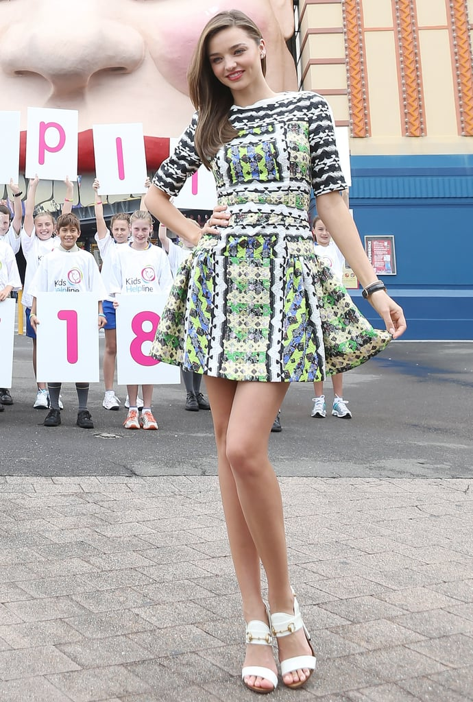 Miranda Kerr showcased a bright printed Peter Pilotto minidress, then accessorised it perfectly with understated white sandals in Sydney.