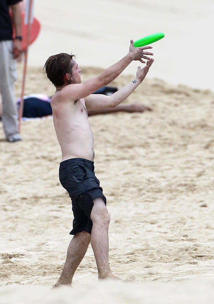 Josh Hutcherson caught a frisbee on the beach.