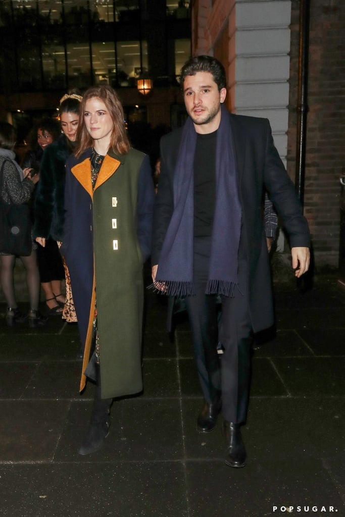 We don't often see Kit Harington and Rose Leslie out and about, so any glimpse of them is a gift. We were lucky enough to receive such a present on Dec. 10 when the Game of Thrones costars-turned-spouses attended MS Society's Carols by Candlelight in London. While Kit sported a longline jacket with a navy scarf, Rose rocked a colorblock coat over a dress. The bundled duo — who wed in June 2018 — appeared to be enjoying the night as they walked side by side and shared a few laughs.  Kit has a big year ahead of him with his roles in The Death and Life of John F. Donovan and Marvel's The Eternals. Rose is also currently filming the 2020 drama Death on the Nile, so there's plenty to look forward to from the pair. Until then, look ahead to see more snaps from their recent London outing!