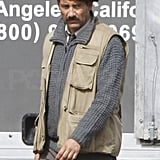 Clive Owen Manages to Pull Off the Tricky Mustache, Beret, and Vest Combo