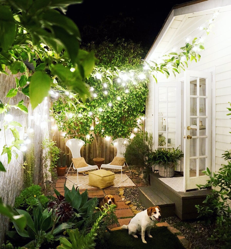 """The softly glowing backyard is warm and welcoming thanks in large part to twinkle lights. """"Twinkle lights are the simplest way to make an outdoor space look and feel magical,"""" says Whitney."""