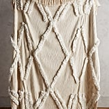 The Anthropologie Aldalora Throw Blanket ($128) is neutral enough to go with all her decorative pillows.