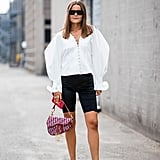 Balance proportions and give biker shorts a chic finish with a puff-sleeve top.