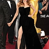 Angelina Jolie showed off major red-carpet glamour at the Oscars in a black high-slit gown by Versace Atelier.