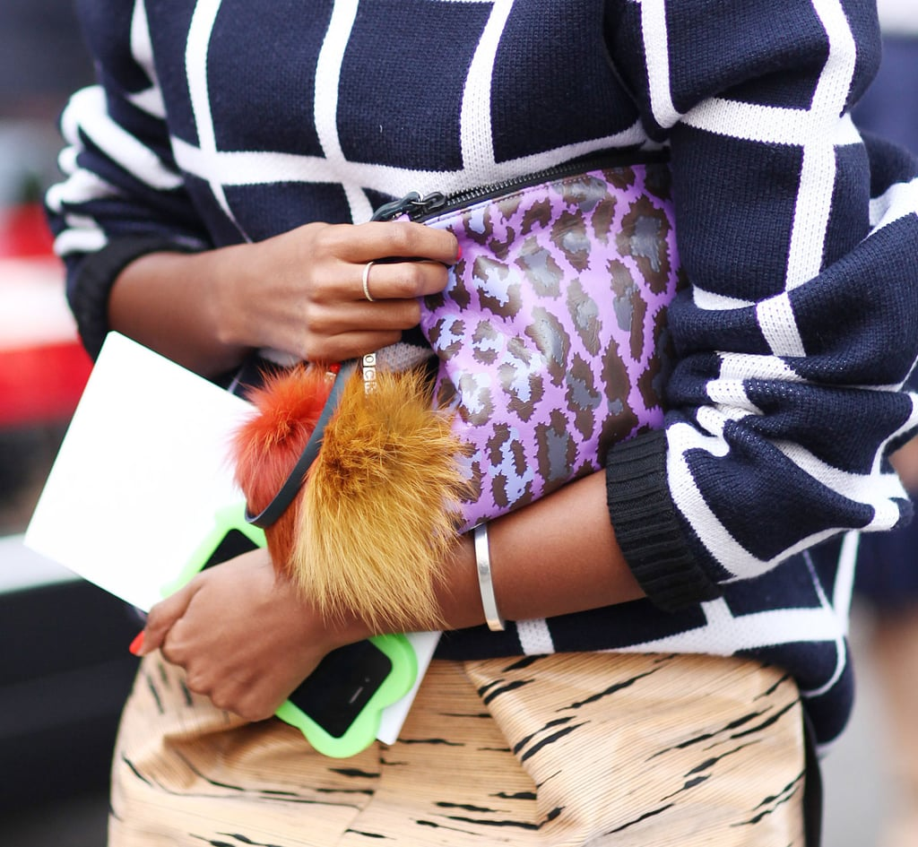 Accessories on accessories. Julia Sarr-Jamois toted a neoprene Christopher Kane pouch finished with a fur tassel. Source: Greg Kessler