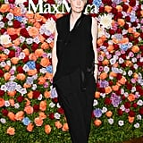 In a sea of colorful buds, Kate Lanphear stood out in her black jumpsuit while feting Max Mara.