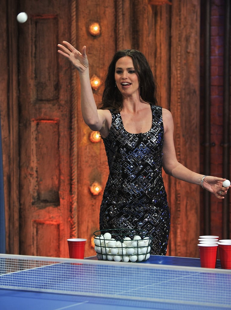 Jennifer Garner stopped by Late Night With Jimmy Fallon yesterday and after the two chatted about her kids, husband Ben Affleck, and movie Arthur, he asked her to step onto his famous beer pong court. Jennifer asked for a handicap, since she has never played before, but apparently she didn't need it. Her nanny, who is taking care of the girls while Jennifer is in NYC, gave the actress tips on where to stand behind the ping-pong table, so she easily defeated Jimmy. While Jennifer is premiering and promoting Arthur on the talk show circuit, Ben actually popped up shopping for rugs in Istanbul.