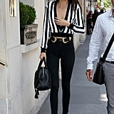 Kendall was recently spotted out and about in Paris, dressed in a striped top and black trousers with this cool double-buckle belt.