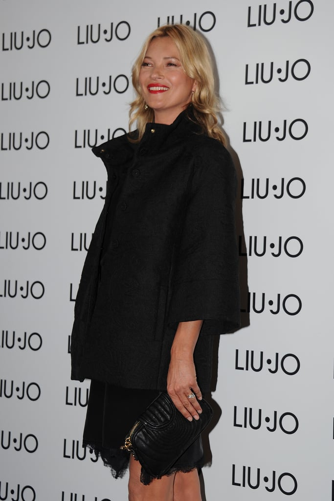 Kate Moss flashed a smile in Milan.
