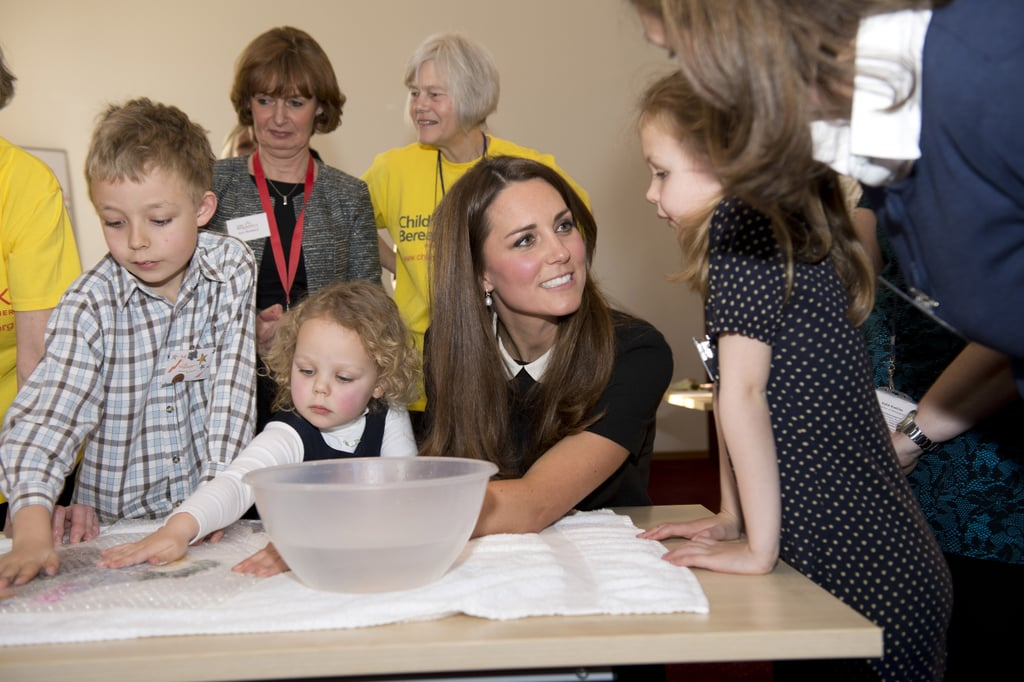 Kate listened intently to a little girl as she visited the offices of Child Bereavement UK in March 2016.