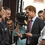 Prince Harry talks with the firefighters.