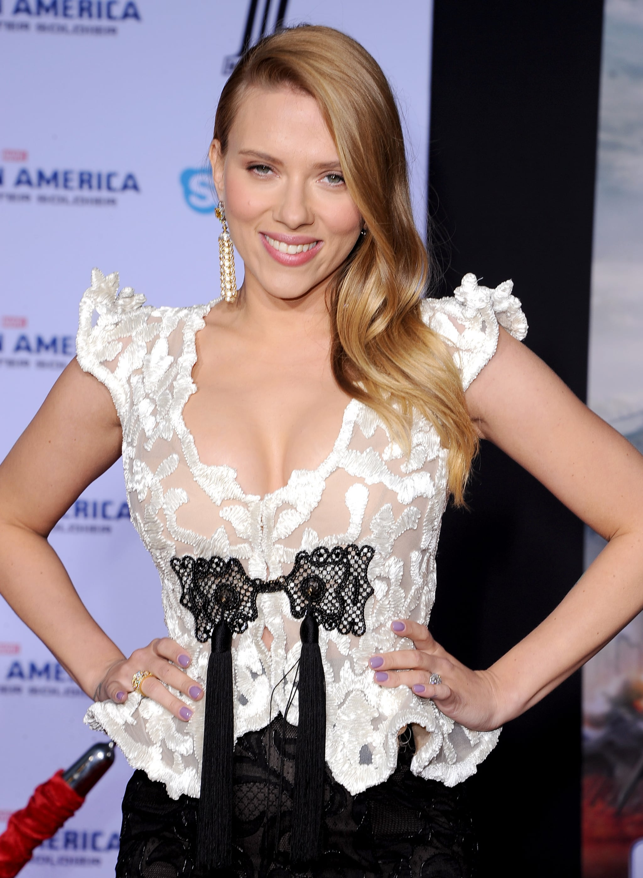 Scarlett Johansson took the red carpet by storm at the world premiere of Captain America: The Winter Soldier in LA on Thursday night, flashing her megawatt smile as fans screamed her name.