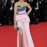 Freida Pinto donned a sweetheart-cut pink Michael Angel gown with a lizard sequin-embellished Salvatore Ferragamo minaudière and silver Louis Vuitton sandals.