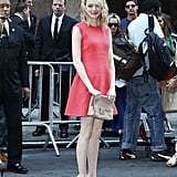 Emma Stone's t-strap heels lent extra personality, thanks to their shape and their brilliant color.