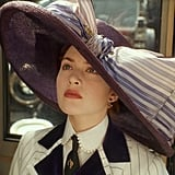 The hat steals the scene, making even everyday clothing far more glamorous.