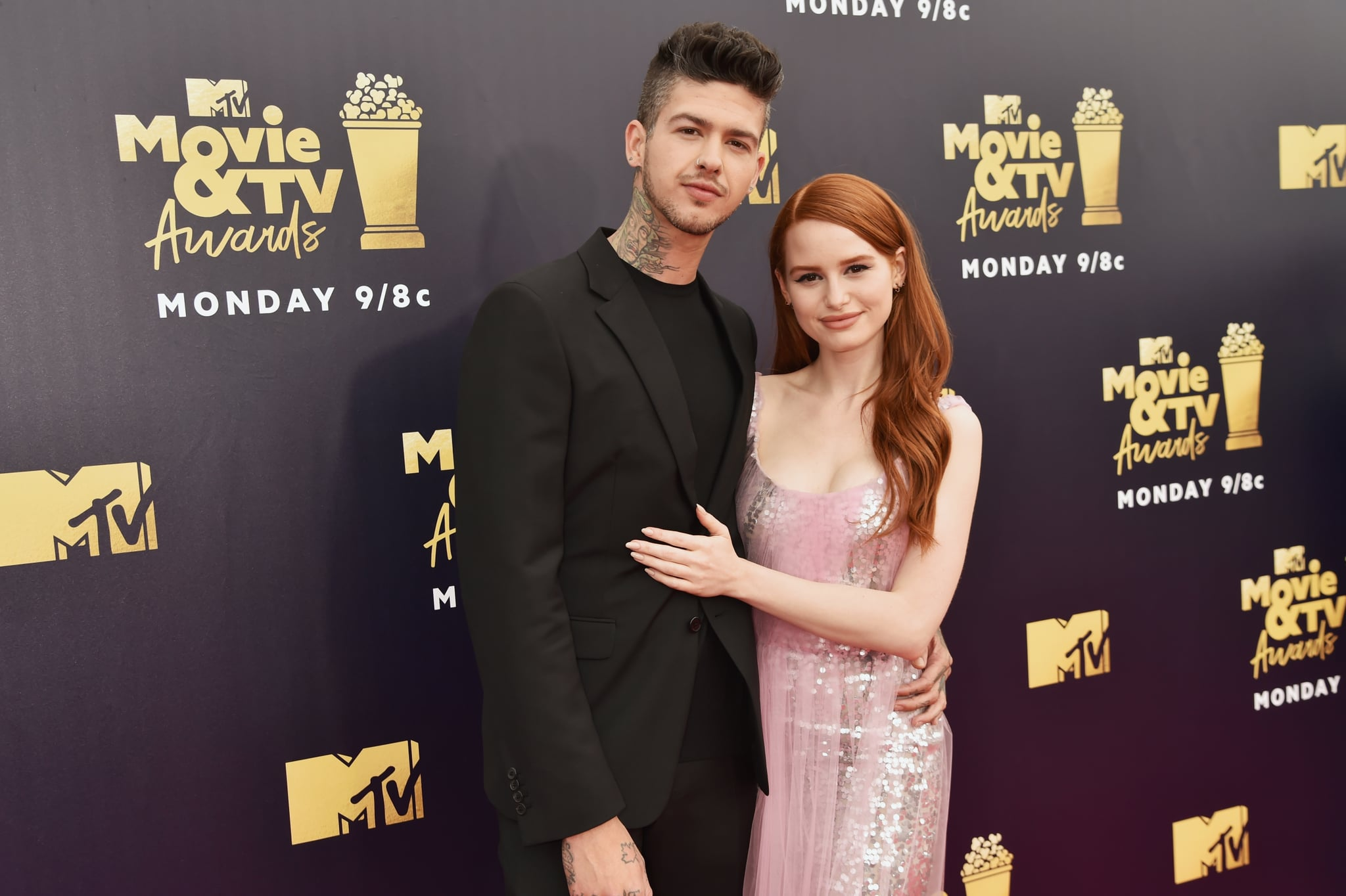 SANTA MONICA, CA - JUNE 16:  Actors Travis Mills (L) and Madelaine Petsch attend the 2018 MTV Movie And TV Awards at Barker Hangar on June 16, 2018 in Santa Monica, California.  (Photo by Jeff Kravitz/FilmMagic)