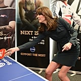 Her suit was so functional that she even got in a round of ping-pong.