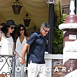 Amal Clooney White Dress and Black Hat in Italy 2019