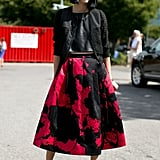 Eva Chen paired her girlie-cool Tibi skirt with a perforated jacket.