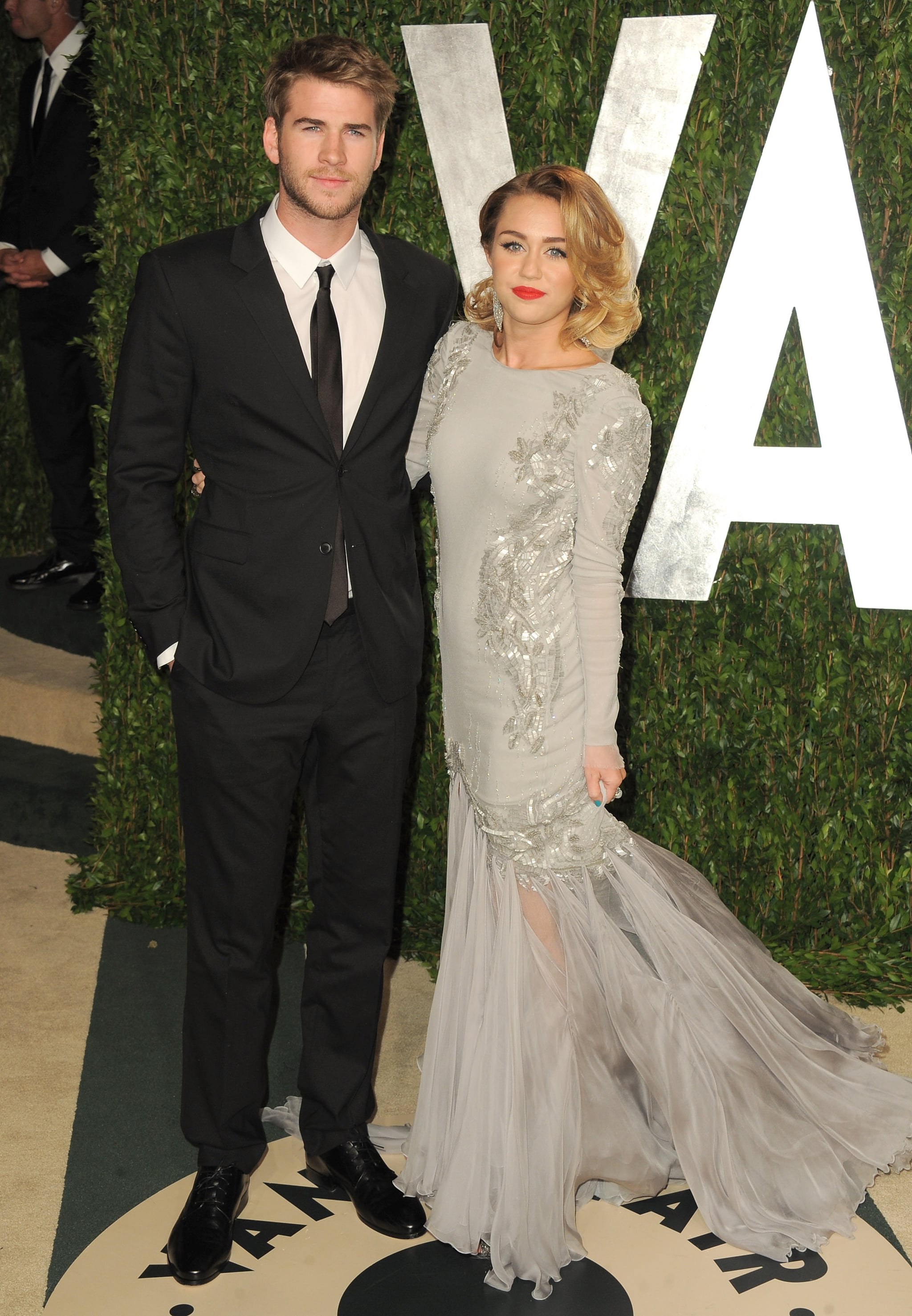 Miley Cyrus and Liam Hemsworth strike a post at Vanity Fair.