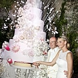 "Their wedding cake was the centerpiece of the reception. In addition to the 110 pounds of strawberries, the cake also featured 2,000 edible flowers including Proteas, South Africa's national flower. Most of the ingredients were picked from Roc Agel, the estate that Monaco's Prince Rainier III gave to Grace Kelly as a wedding present in 1956.  The wedding almost didn't happen. Just a week before the lavish affair, it was reported that the former South African Olympic swimmer, who was 33 at the time, tried to escape Monaco and had her passport seized by police at the airport in France. The alleged attempt came amid rumors that Albert had fathered an illegitimate child when they were together. Charlene later dispelled those rumors, telling Vogue in 2011, ""It is a shame that those rumors came at such a bad time, but I think they were timed to sabotage such a happy occasion. They are categorical lies. I won't dignify them with any response other than to say that the photographs of me and Albert in love and getting married will speak louder than any vicious gossip and empty rumors."""