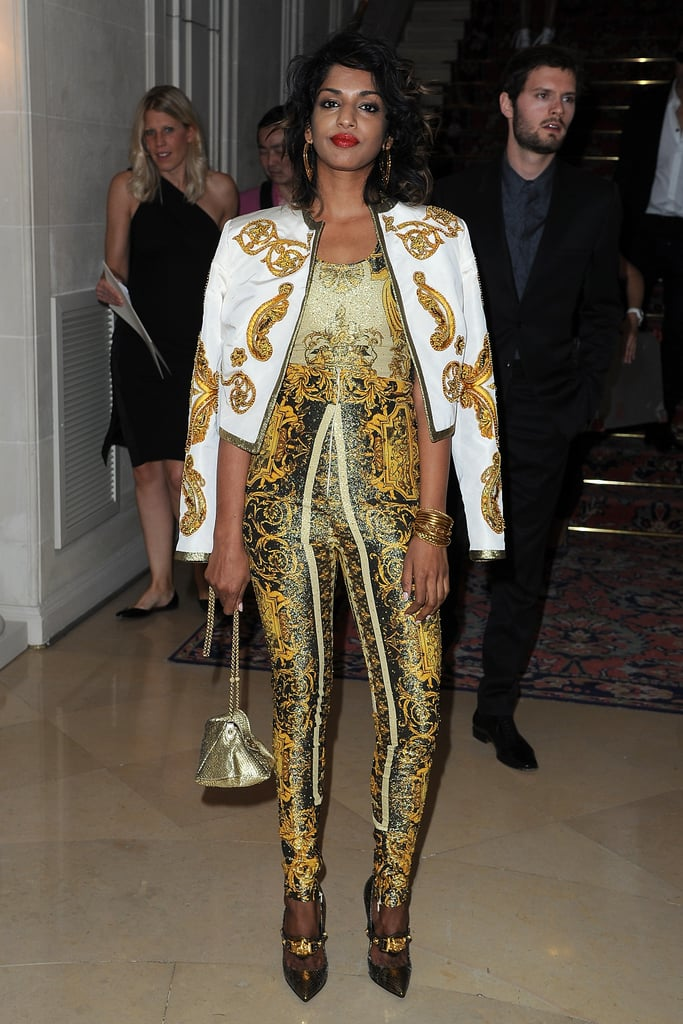 M.I.A. was outfitted in decadent Versace prints on prints: she wore a pair of fitted pants and a coordinating top and jacket.