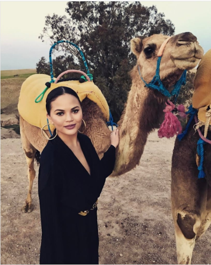 Chrissy Teigen in Black Jumpsuit in Morocco