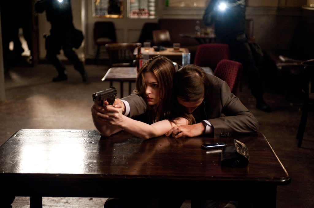 Anne Hathaway and Burn Gorman in The Dark Knight Rises.