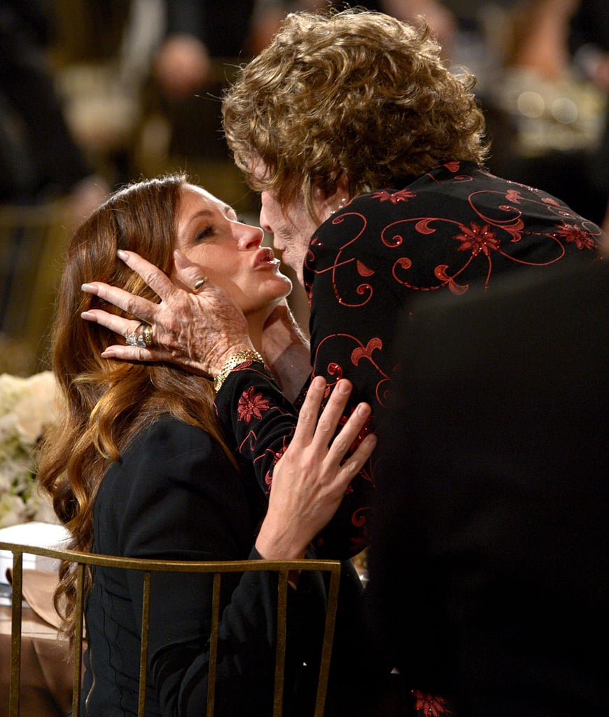 Shirley MacLaine was congratulated by Julia Roberts at the AFI Life Achievement Award dinner in LA.