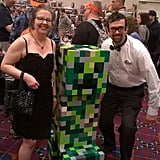 Here's the married couple posing with a Minecraft character.