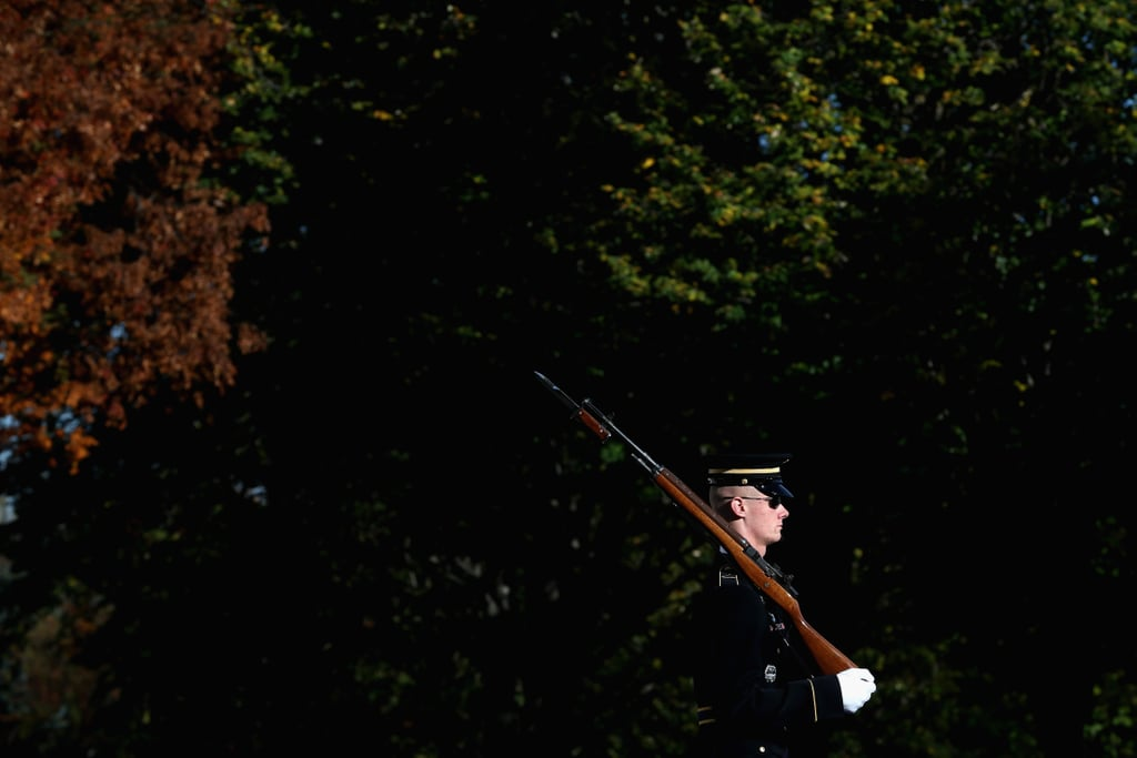 A member of the military color guard stood at attention during a wreath-laying ceremony at Virginia's Arlington National Cemetery.