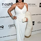 Kim had her bump on display in a white gown at Elton John's Oscars-viewing party in LA in February 2013.