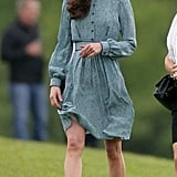 The dress has a shirtdress silhouette, perfect for a casual day event.