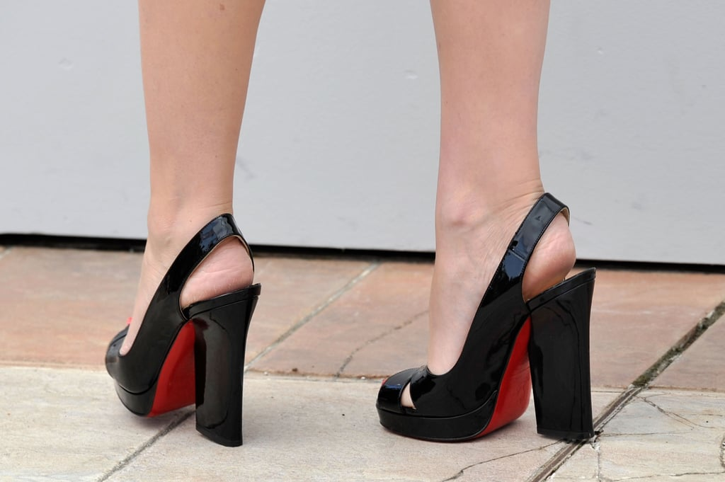 Kylie donned chunky patent leather slingback pumps at the Holy Motors photocall.