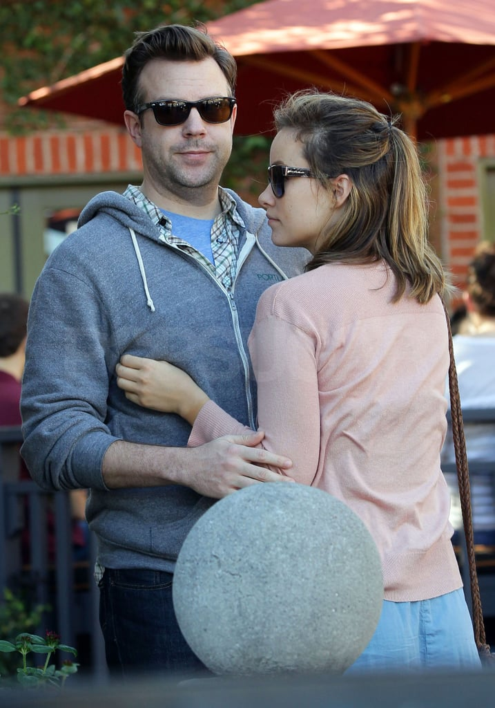 Jason and Olivia shared some PDA waiting for their car.
