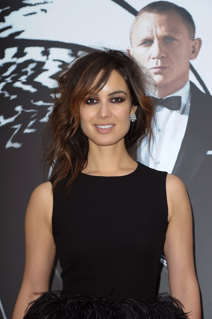 Bérénice Marlohe wore a black dress at a photocall in Paris.