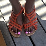 Showing off her strappy sandals, Mindy Kaling gave us a peek of her pretty pink pedicure. Source: Instagram user mindykaling