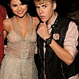 Justin Bieber and Selena Gomez with their arms around each other.