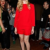 Elle Fanning punched up the Marc Jacobs front row in a fiery red top and matching shorts, then finished with black strappy sandals. Follow suit by wearing all-red up top, then finishing off with black footwear.