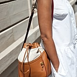 A bucket bag was the perfect low-key Summer complement to this LWD.
