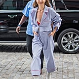What matches: Gigi's Le Specs sunglasses and the cherry-red lining on her Christian Dada pajama set. Gigi also let a Fleur Du Mal bra in the same shade peek out from her top, grounding the outfit with neutral Stuart Weitzman boots.