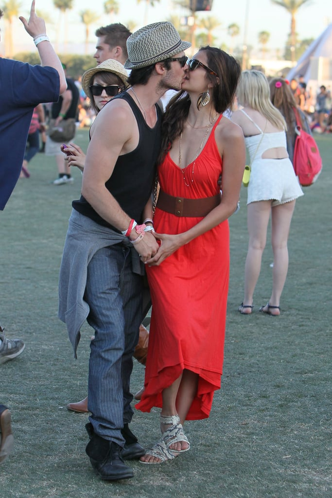 Nina Dobrev and Ian Somerhalder were just a few of the stars at Coachella in Indio, CA, this weekend. Yesterday the couple popped up at Burton's BBQ at the ACE Hotel, where they posed for photos together and Ian stopped to chat with us poolside. Nina and Ian continued the fun at Armani Exchange's Neon Carnival last night. They were back in action today at the festival grounds, kissing and cuddling as they headed to a show.