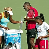 Richard Williams with daughters Serena and Venus at morning practice during the 2002 US Open in Flushing Meadows, NY.