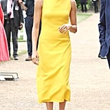 Possibly shining brighter than the sun, Meghan stepped out for the Commonwealth youth reception in July 2018 wearing a high-neck midi yellow Brandon Maxwell dress. She completed her look with neutral heels and Adina Reyter earrings.