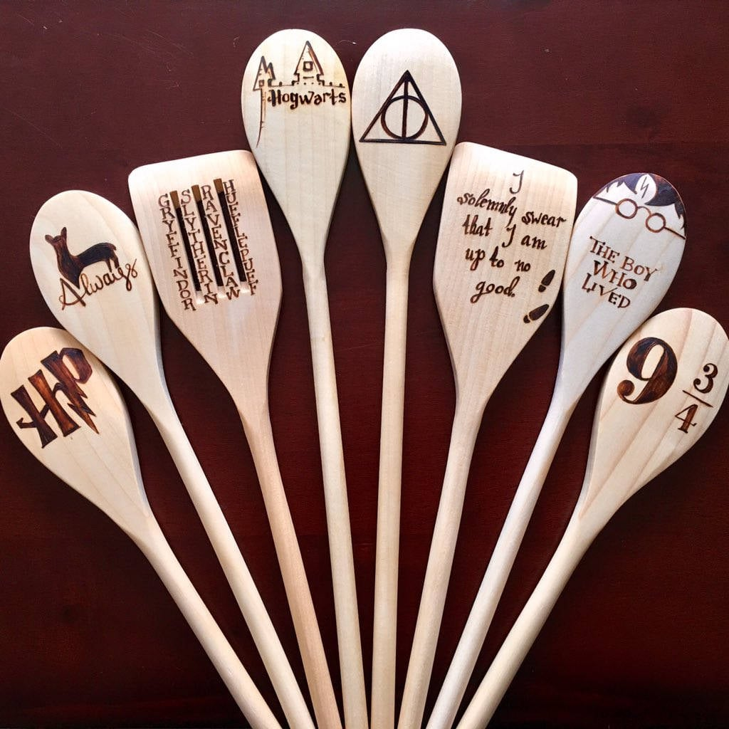 Every home cook knows that while we love tasting our creations, accumulating a wide variety of fun cooking products is another big reason to fire up your burners. And while we're obsessed with our as-seen-on-TV zoodler, we have a hunch that even Draco Malfoy would agree these Harry Potter Wooden Spoons ($11 for one, $68 for the collection) will become your cast iron skillet's new best friend.  Scroll through to get a look at these gorgeous wooden spoons, which feature whimsical images of everything from Hogwarts to platform 9 3/4. Pro tip: keep in mind that although these spoons are technically dishwasher safe, the seller recommends that you hand wash them.       Related:                                                                                                           We Give MANY Hufflef*cks About These Harry Potter Swear Word Wine Glasses