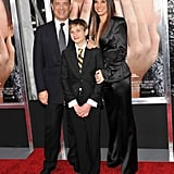 Sandra Bullock and Tom Hanks posed with their young costar, Thomas Horn on the red carpet.
