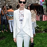 Anne Hathaway wore an all white ensemble to the Stella McCartney presentation in NYC.