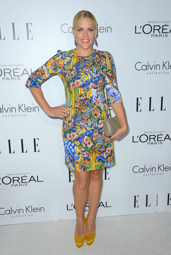 Busy Philipps lit up the arrivals in a bold printed sheath and coordinating marigold pumps.